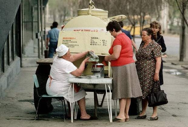1987, Volgograd, USSR --- A woman on a street in Volgograd sells some sort of liquid for the invalids of the Great Patriotic War (the Soviet name for World War II). --- Image by © David Turnley/CORBIS