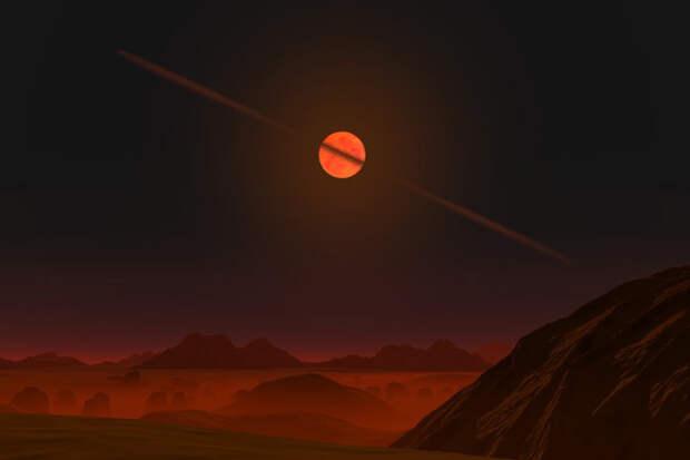 Вид с поверхности экзопланеты на коричневый карлик с астероидным диском (в представлении художника)