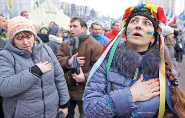 Поющую в Киеве гимн России девушку избили разъяренные украинцы