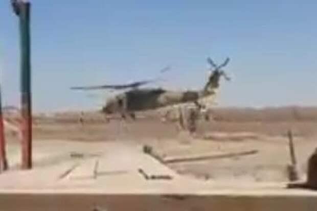 В Афганистане американцы бежали с военной базы на вертолете