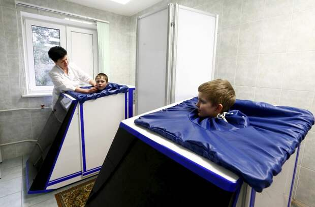 Children, who permanently live at the territory contaminated with radionuclides after the Chernobyl nuclear power plant accident, take physiotherapy while they are in a children's rehabilitation and health centre on the outskirts of Minsk
