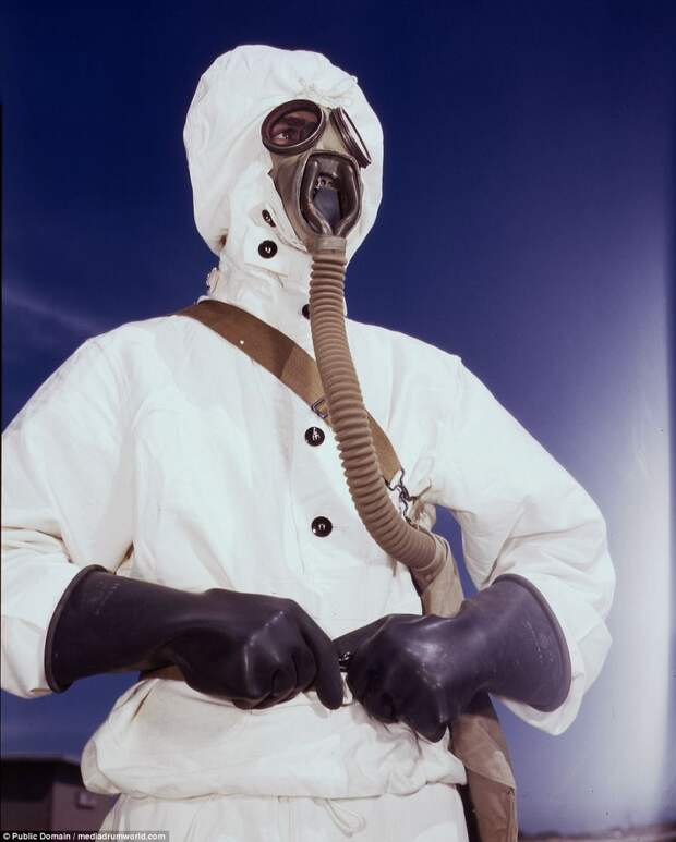 A sailor at the Naval Air Base wears the new type protective clothing and gas mask designed for use in chemical warfare, in Corpus Christi, Texas, in August of 1942