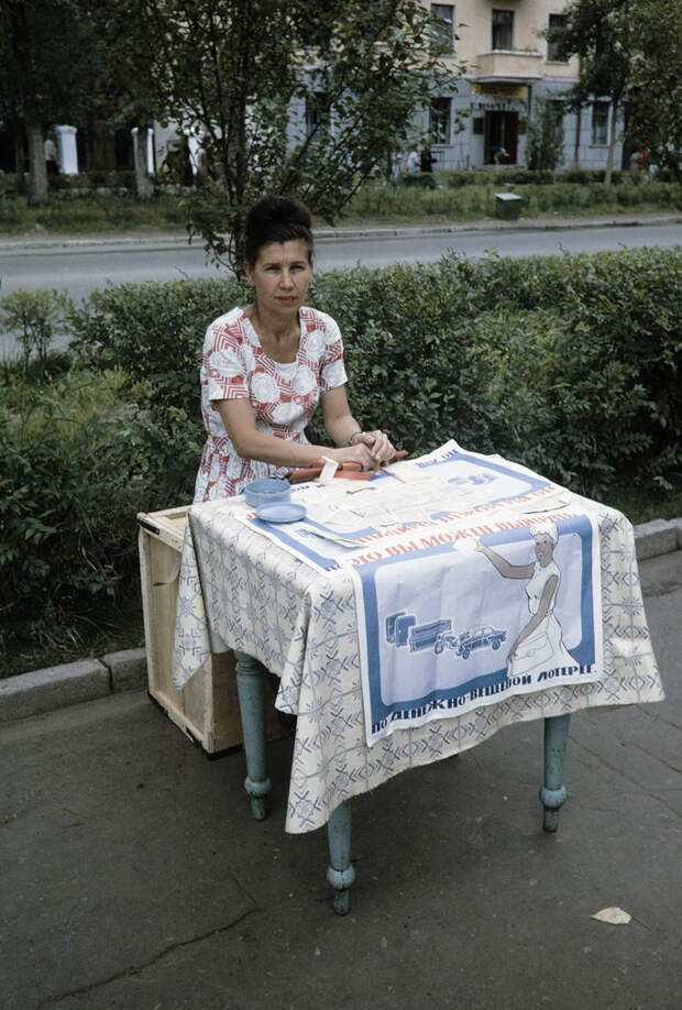 Russia, woman selling lottery tickets in Khabarovsk