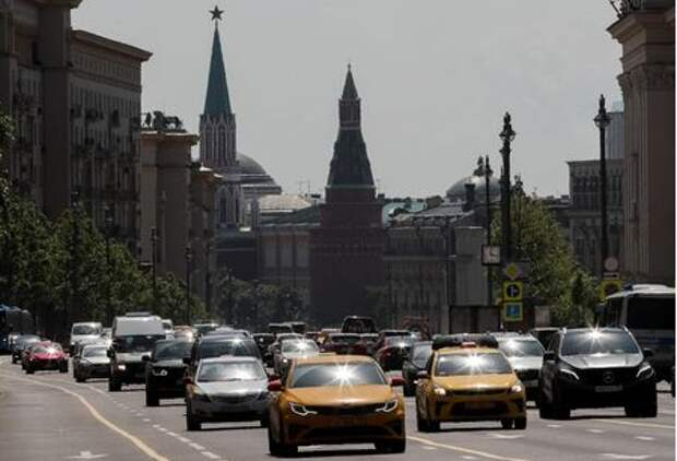 Cars drive along a road on a sunny day, after a lockdown designed to curb the spread of the coronavirus disease (COVID-19) was lifted in Moscow, Russia June 9, 2020. REUTERS/Shamil Zhumatov
