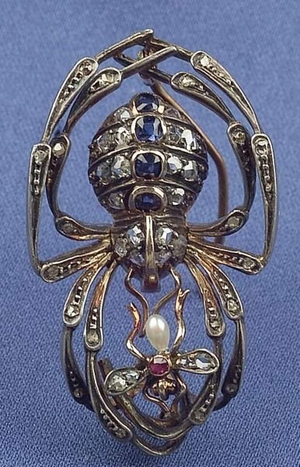 Sapphire, ruby, diamond, pearl, silver and gold brooch, depicting a spider which has caught a fly.