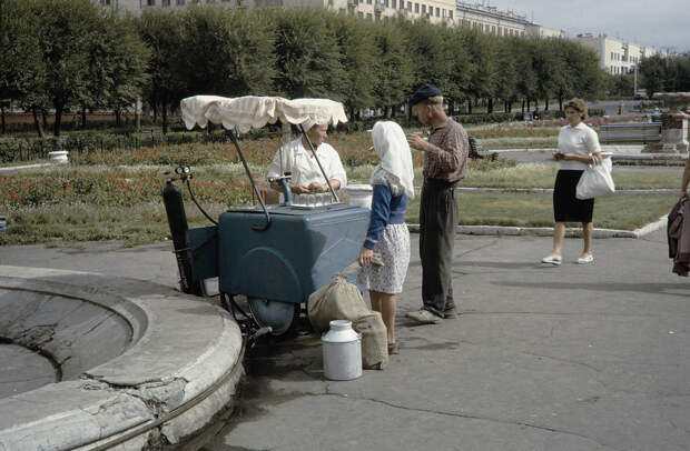 Russia, people buying drinks from vendor in Khabarovsk