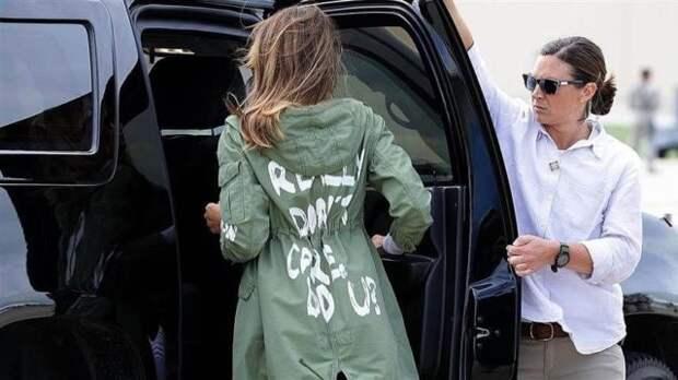 мелания трамп в зеленой парке
