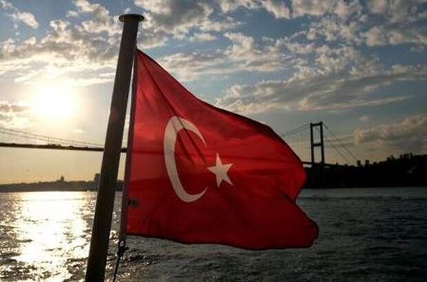 A Turkish flag with the Bosphorus Bridge in the background, flies on a passenger ferry in Istanbul, Turkey September 30, 2020. REUTERS/Murad Sezer