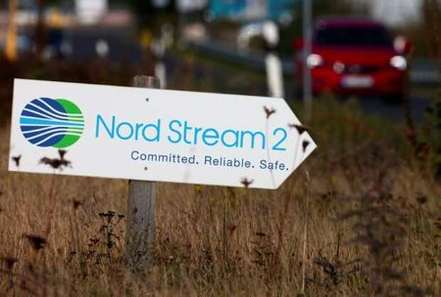 A road sign directs traffic towards the Nord Stream 2 gas line landfall facility entrance in Lubmin, Germany, September 10, 2020. REUTERS/Hannibal Hanschke