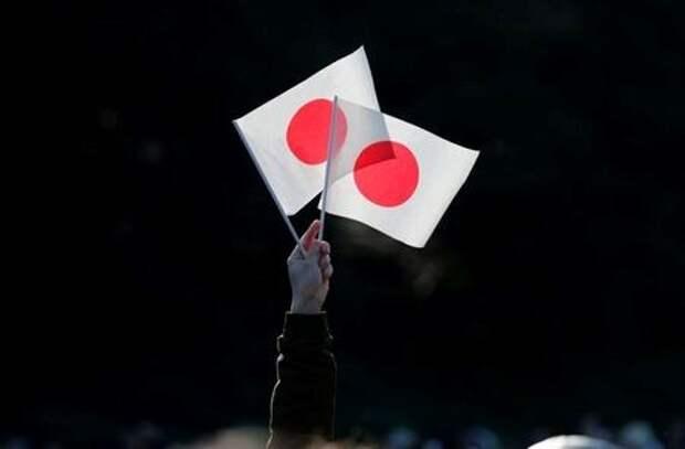 Флаги Японии, Токио, Япония, 2 января 2020 года. REUTERS/Kim Kyung-Hoon
