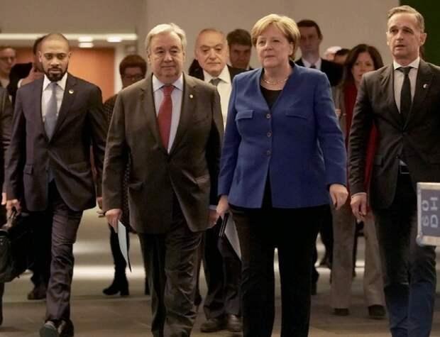 Участники саммита в Берлине договорились об отказе от поставок оружия в Ливию